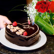 Birthday cake and roses — Stock Photo