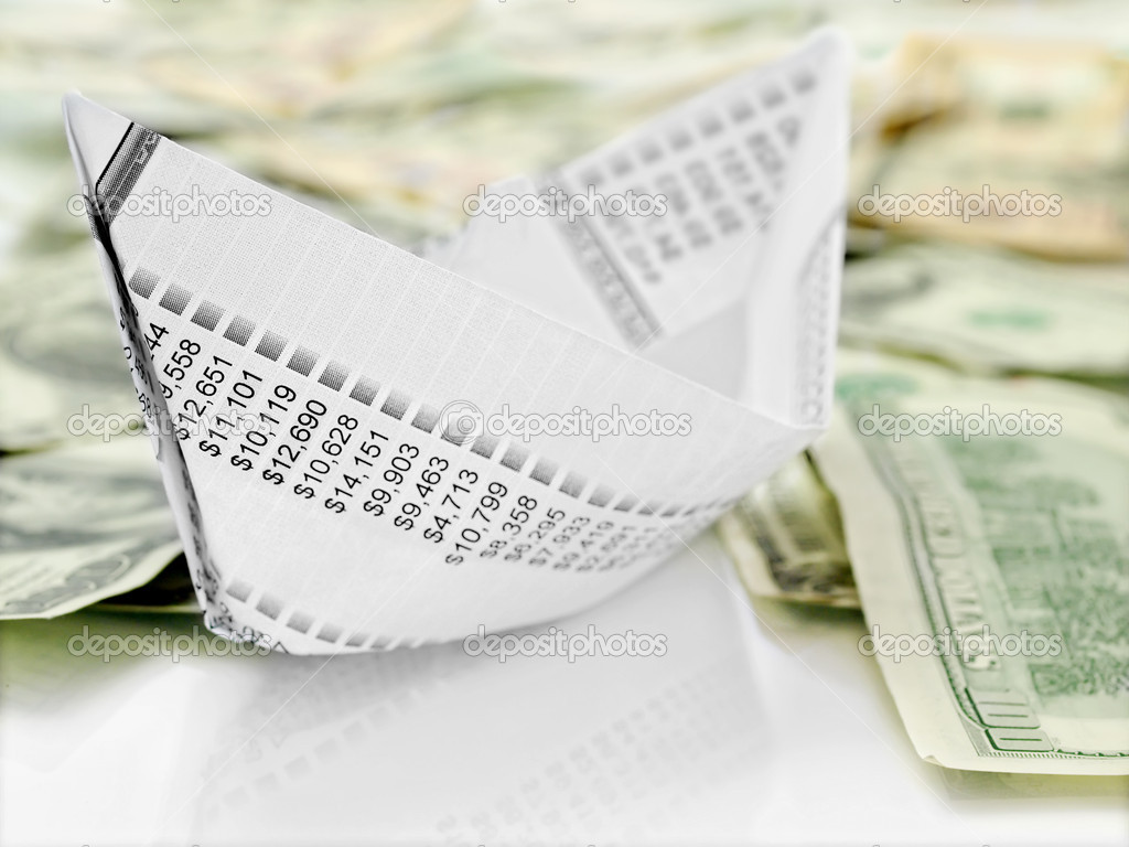 Origami  paper boat made from financial  document on money background — Stock Photo #9350028