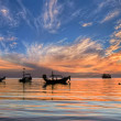Sunset with longtail boats on tropical beach. Ko Tao island, Tha — Stock Photo
