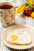 Heart shape fried egg — Stock Photo