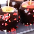 Apples in chocolate — Stock Photo
