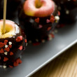 Stock Photo: Apples in chocolate