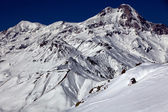 Freerider on the background of Mount Kazbek — Stock Photo