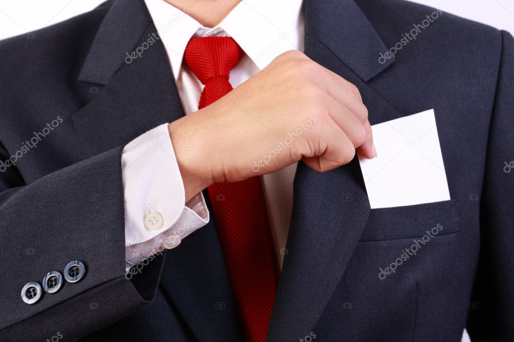 Business man holding blank white card within his pocket — Stock Photo #9844663