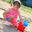 Royalty-Free Stock Photo: Girl playing alone in the sandpit