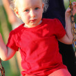Stock Photo: Portrait of little girl on swing