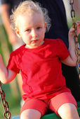 Portrait of a little girl on a swing — Stock Photo