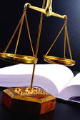 Scale of justice and books — Stock Photo