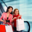 Stock Photo: Two young women shopping