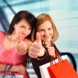 Two women shopping - Stock Photo