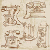 Set of Vintage Telephones - hand drawn in vector — Stock Vector