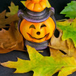 Halloween Lantern and Leafs on Black Background — Stock Photo