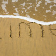 Stock Photo: Word Time on sand