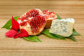 Cheese with mold and pomegranate — Stock Photo