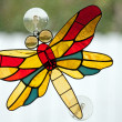Stained leaded glass dragon fly — Stock Photo