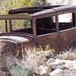 Постер, плакат: Old junk car in the nevada desert in Nelson Eldorado Canyon