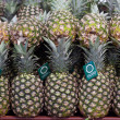 Pineapples on display in store — Stock Photo