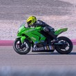 Motor bike racer on track — Stock Photo #9020786