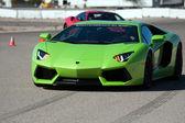 Green ItalianLamborghini car on track — Stock Photo
