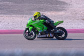 Motor bike racer on track — Stock Photo