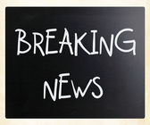 """Breaking news"" handwritten with white chalk on a blackboard — Stock Photo"