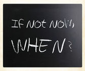 """If not now, when?"" handwritten with white chalk on a blackboard — Stockfoto"