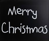 """Merry Christmas"" handwritten with white chalk on a blackboard — Stock Photo"