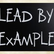 """Lead by example"" handwritten with white chalk on a blackboard — Stock Photo #8371404"