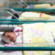 Newborn baby inside incubator — Stock Photo