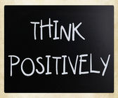 """Think Positively"" handwritten with white chalk on a blackboard — Stock Photo"