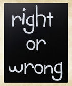 """Right or wrong"" handwritten with white chalk on a blackboard — Stock Photo"