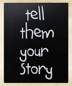 """Tell them your story"" handwritten with white chalk on a blackbo — Stock Photo"