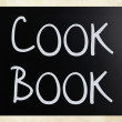 """Cook book"" handwritten with white chalk on a blackboard - Stock Photo"