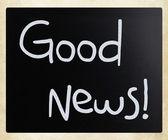"""Good News!"" handwritten with white chalk on a blackboard — Stock Photo"