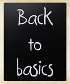 """Back to basics"" handwritten with white chalk on a blackboard — Stock Photo"