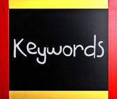 "The word ""Keywords"" handwritten with white chalk on a blackboard — Stock Photo"