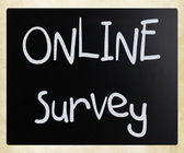 """online survey"" handwritten with white chalk on a blackboard — Stockfoto"