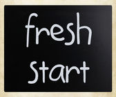"""fresh start"" handwritten with white chalk on a blackboard — Stock Photo"