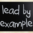 """Lead by example"" handwritten with white chalk on a blackboard — Foto de Stock"