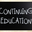 "Stock Photo: ""Continuing Education"" handwritten with white chalk on blackbo"