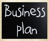 """Business plan"" handwritten with white chalk on a blackboard — Foto Stock"