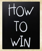 """How to win"" handwritten with white chalk on a blackboard — Stock Photo"