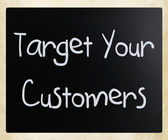 """Target your customers"" handwritten with white chalk on a blackb — Stok fotoğraf"