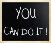 """You can do it"" handwritten with white chalk on a blackboard — Stock Photo"