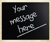 """Your message here"" handwritten with white chalk on a blackboard — Stock Photo"