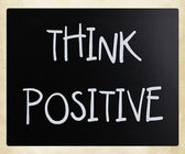 """""""Think positive"""" handwritten with white chalk on a blackboard — Stock Photo"""