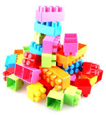Plastic building blocks on a white background — Stock Photo