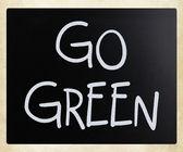 """Go green"" handwritten with white chalk on a blackboard — Stock Photo"