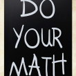 "Stockfoto: ""Do your math"" handwritten with white chalk on blackboard"