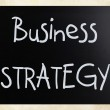 """Business strategy"" handwritten with white chalk on a blackboard — Stock Photo #9717015"